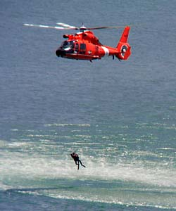 [Photo of helicopter performing sea rescue demonstration]